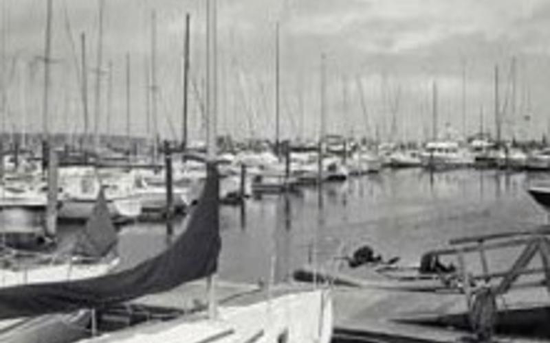"Photo offset lithography. Richard Benson. Bend Boat Basin. 1985. 9 1/2 x 7 1/2"" (24.1 x 19 cm). A tritone print in black, dark gray, and light gray ink. © Richard Benson"